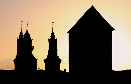 Silhouettes of a Church and a huge Tower.