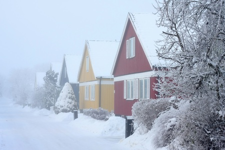 Houses in cold,chilly and frosty winter climate.
