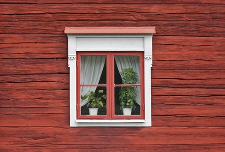 Cute window on red swedish house wall Stock Photo