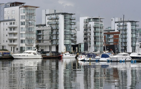 Modern apartments by the sea with modern boats and classy style. Stock Photo - 11553687