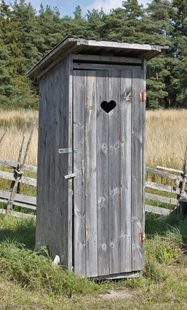 latrine: Small wooden outdoors toilet in summer. Stock Photo