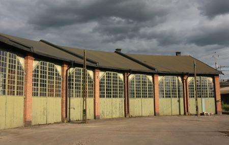 Old romantic storage building with huge doors and glass windows  Stock Photo