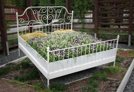 A bed of flowers, literally  A symbol for flowerbeds, sleep, relaxation and gardening  Editorial