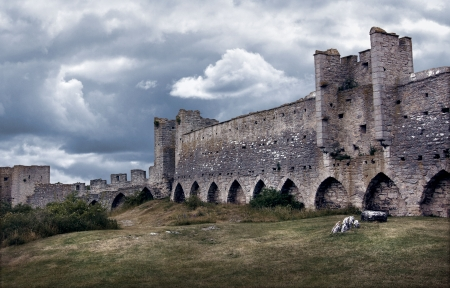Medieval city wall in dark dramatic tones and colors. Stock Photo