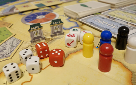 game board: Games and dices, playcards, figurines and symbols. Casual leisure gaming.
