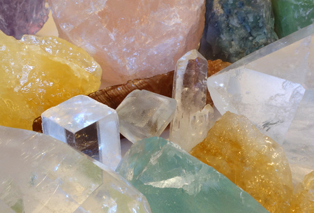 treasure hunt: Cave of crystals with colourful minerals and gems. Symbol for treasure hunt and rough mineral specimens. Stock Photo
