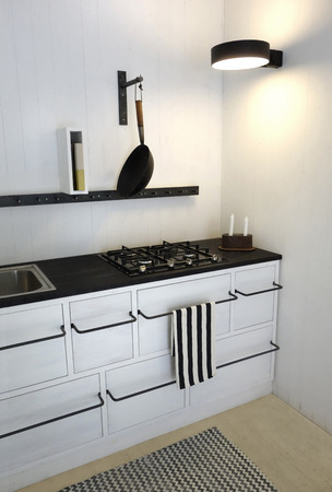 Retro Kitchen in bright white colors. Minimalistic, sparse and contemporary interior design.