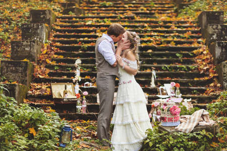 Decorating in retro style for weddings, anniversary in the autumn forest. Toned image.