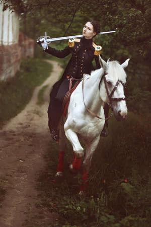 white suit: Uniform explanation of the 19th century. White horse. Toned image. Stock Photo