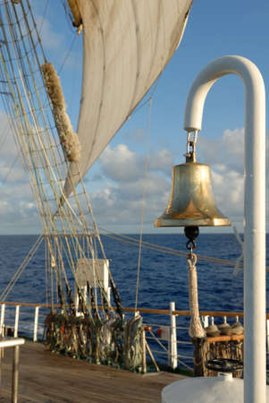 Romantic Sailing  Bell and sea sail on the ocean background photo