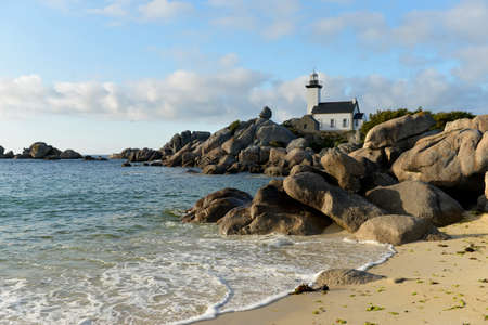 old lighthouse on the rocks,Brittany, France photo