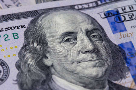 Closeup of a hundred dollar bill. Background of dollar bills. American Dollars Cash Money. Benjamin Franklin's portrait