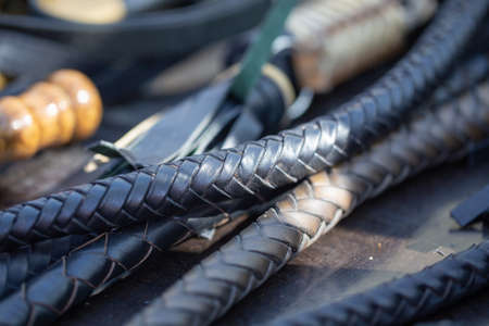 handles woven leather whips. texture of vintage instruments.