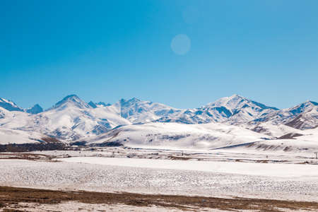Mountains with melting snow. The end of winter, the beginning of spring. Kyrgyzstan Tourism and travel