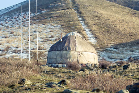 The ancient dwelling of the peoples of Asia is a yurt. In the mountains in winter. Stock fotó