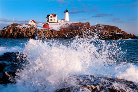 Maines Cape Neddick (Nubble) Lighthouse guides mariners at high tides during the holiday season. Stock Photo