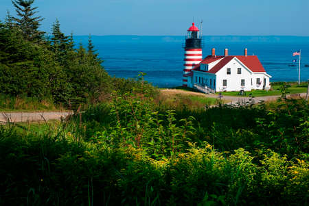 West Quoddy head Lighthouse lies on the easternmost point of the United States, in Lubec Maine. It is also the first place the sun rises in America.