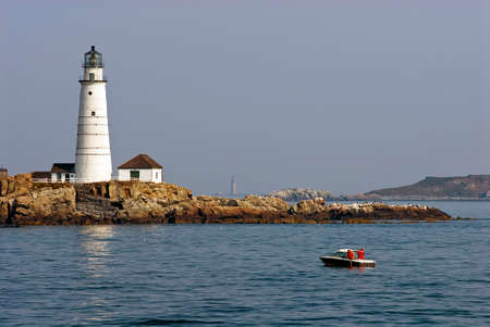 guiding light: Boston Harbor lighthouse is the oldest lighthouse in America   Stock Photo