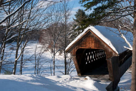 Covered bridge after snowfall in New England  photo