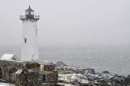 Portsmouth Harbor Lighthouse in snowstorm on the New Hampshire coast  Stock Photo