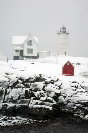 guides: Cape Neddick Nubble lighthouse in Maine guides mariners year round through snowstorms and rain. Stock Photo