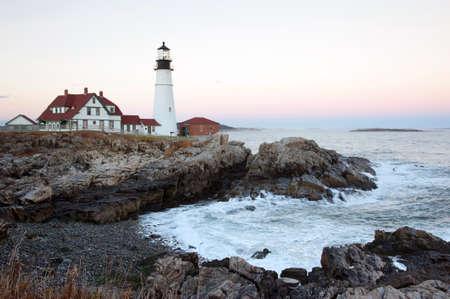 portland: Portland Head lighthouse at dusk in Maine.