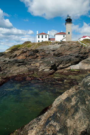 visitors area: Beavertail lighthouse park is a favorite area for visitors to explore or relax along its unique rock formations. Stock Photo