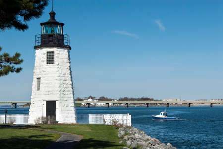 lobster boat: Lobster boat passes by Newport Harbor Lighthouse in Rhode Island