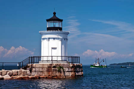 trawler: Portland Breakwater Lighthouse, also referred to as Bug Lighthouse, guides a fishing trawler home.