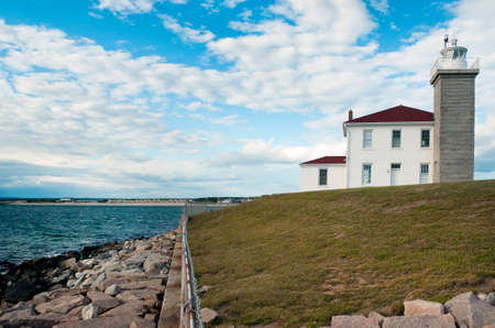 guiding light: Watch Hill Lighthouse guides mariners along its rocky shoreline in Rhode Island.