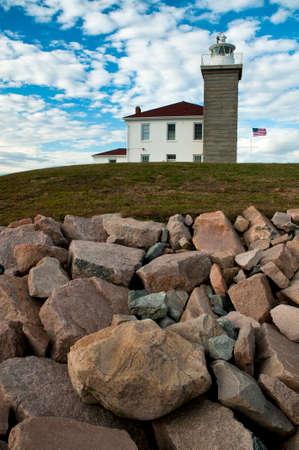guiding light: Watch Hill Lighthouse guards the rocky Rhode Island coast.