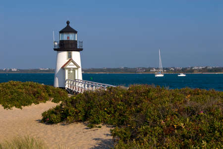 Brant Point Lighthouse guides boaters in the Harbor of Oak Bluffs on Nantucket Island. Stock Photo
