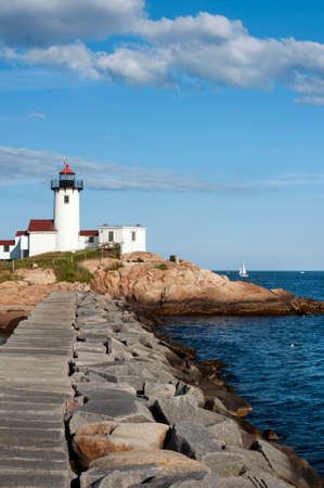 eatern: Eastern Point Lighthouse in Gloucester, Massachusetts, offers a nearly one mile view from the jetty. Stock Photo