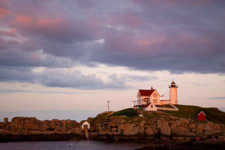knew: Nubble Cape Neddick lighthouse is considered haunted by the ghost ship Isadore that wrecked nearby, which has been viewed by tourists who knew nothing of the story of the ill fated vessel. Stock Photo