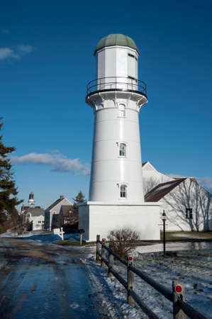 icey: Cape Elizabeth Range lights in winter season. Rear range lighthouse is currently inactive. Stock Photo