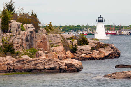 guiding light: Palmer Island lighthouse helps to guide mariners into rocky New Bedford Harbor. Stock Photo