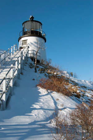 enduring: Historic Owls Head lighthouse sits on a snow covered cliff in Maine.