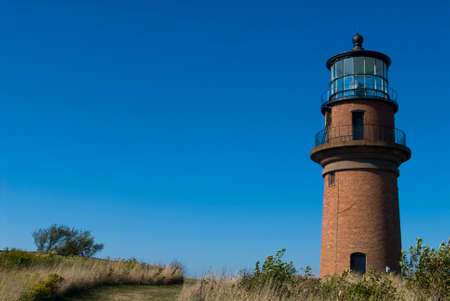 Gay Head light, also referred to as Aquinnah lighthouse is a 450-ton brick tower guiding mariner into Vineyard Sound. Stock Photo