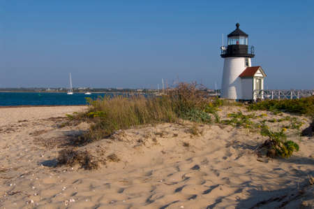 guides: Brant Point lighthouse guides mariners in Nantucket Harbor, in Massachusetts. Stock Photo