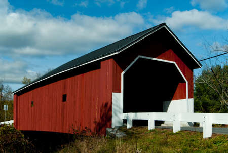 autmn: Carleton covered bridge has a disctinctive red color on a sunny autmn day in New hampshire.