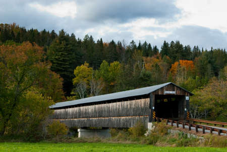 guides: Covered bridge in New England guides travelers in Autumn.
