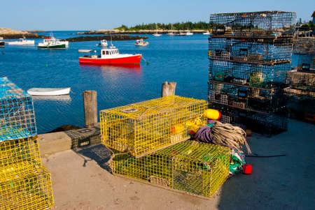 lobster boat: Colorful lobster traps along the dock for lobster boats moored at Matinicus Harbor, in Maine. Stock Photo
