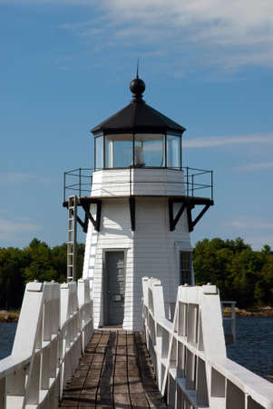doubling: Old wooden walkway leads to lighthouse on Kennebec River, in Maine.