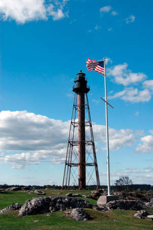 Marblehead Light is a unique skeletal beacon guiding mariners away from the rocky shoreline. Stock Photo