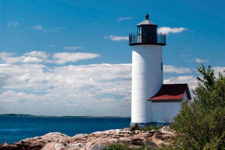 Annisquam Lighthouse overlooks harbor in Massachusetts. Stock Photo