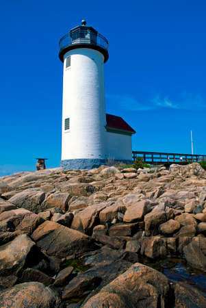 Annisquam lighthouse guides mariners around the rocky coastline of the Massachusetts North Shore.