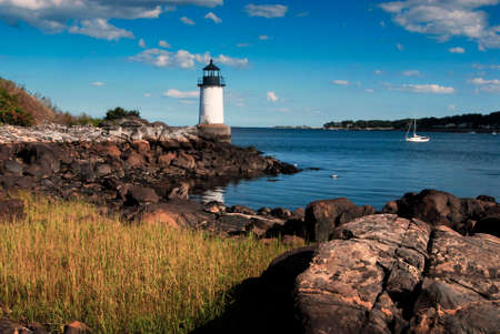 guiding light: Fort Pickering (Winter Island) lighthouse in early evening, in Salem, Massachusetts.
