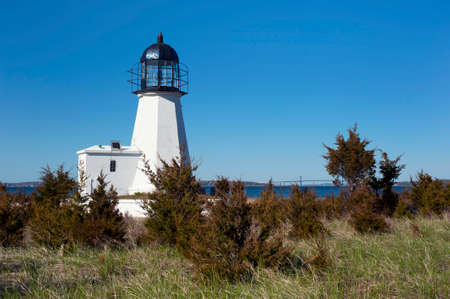 Sandy Point (Prudence Island) lighthouse overlooks Narragansett Bay in Rhode Island.