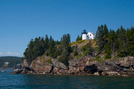 Bear Island lighthouse sits atop a rocky island near Acadia National Park in maine.Acadia Stock fotó