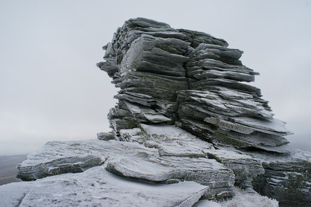 layered rock in the harsh winter weather Stock Photo